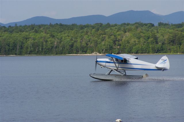 The PA-12 Super Cruiser takes off from Caribou Lake for another North Woods adventure--this can be you!